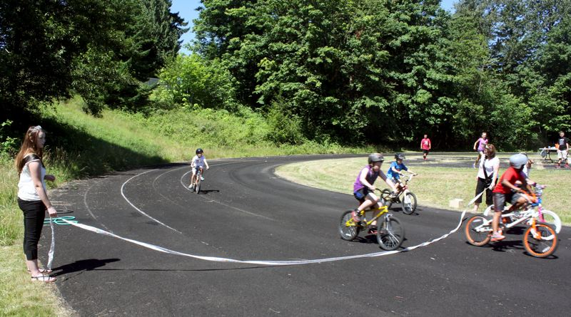 by: POST PHOTO: KYLIE WRAY - Older kids raced the complete .25 mile track.