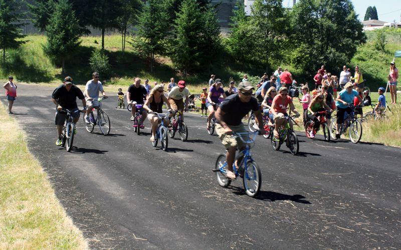 by: POST PHOTO: KYLIE WRAY - Parents closed the derby by racing on their childrens bikes.