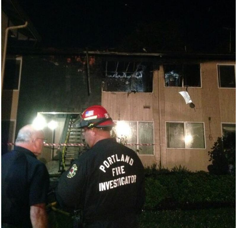 by: COURTESY OF PF&R - Portland firefighters pulled two victims from a second-floor apartment early Friday morning, July 11. One man died in the blaze.