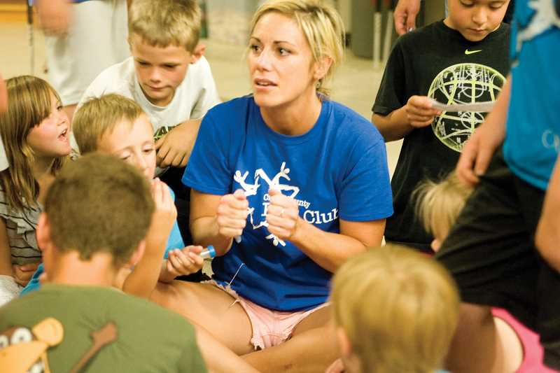 by: KEVIN SPERL - Executive Director Ashley Thrasher can usually be found surrounded by kids at the Crook County Kids Club.