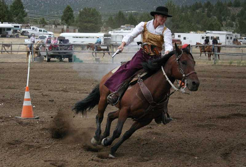 by: JASON CHANEY - Cindy Griggs navigates a mounted shooting pattern on Friday evening.