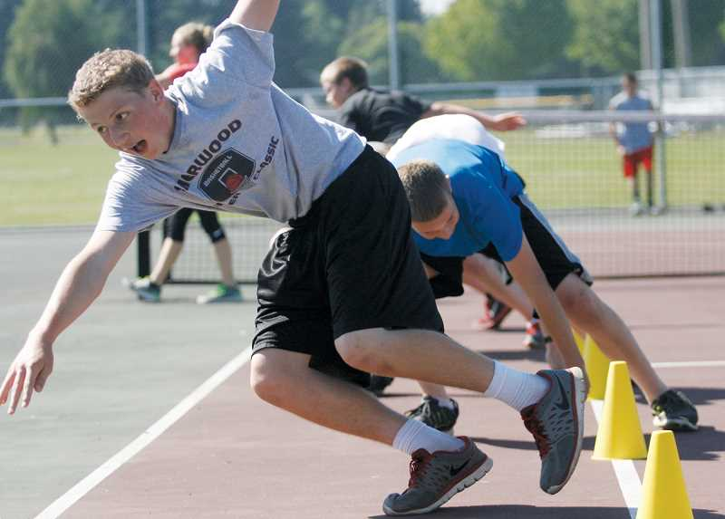 by: PHIL HAWKINS - Students race around cones at North Marion High School's Husky Boot Camp last week.