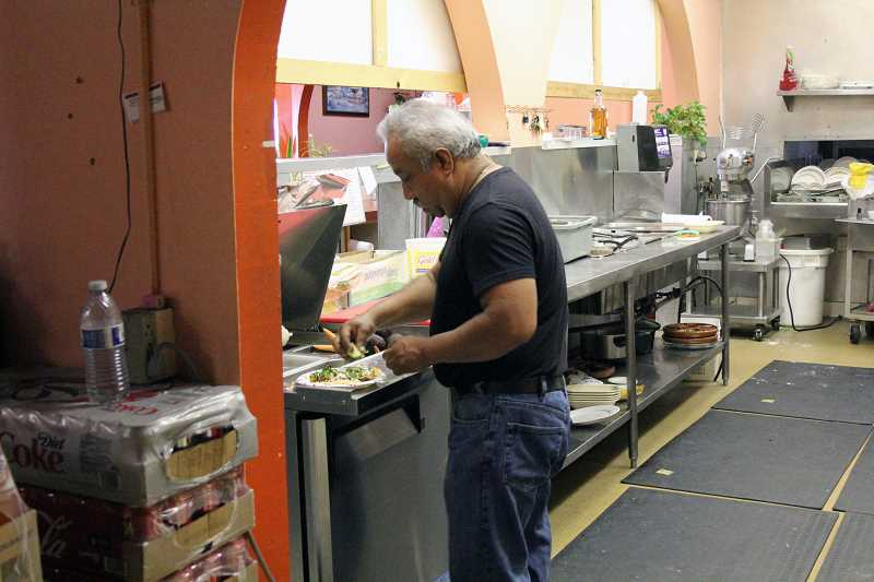 by: TYLER FRANCKE - Lupita's owner Martin Ochoa works in his restaurant's kitchen last week.