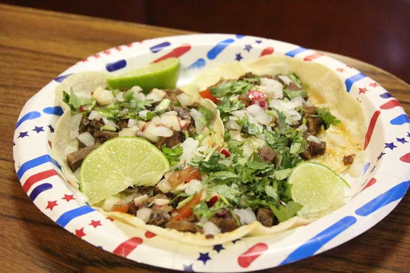 by: TYLER FRANCKE - Pictured is an order of the beef tongue tacos that the crews of Lupita's and the Food Network show 'Carnival Eats' used to have a bit of fun with attendees at the Rose Festival in Portland.