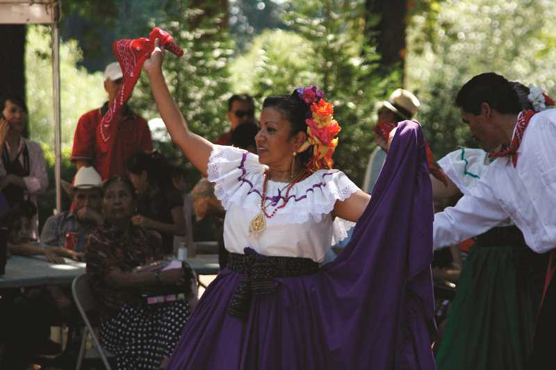 by: FILE PHOTO - The 51st annual Woodburn Fiesta Mexicana, presented by Country Financial, will be Aug. 2-3 at Legion Park. One of the highlights of the annual events is its diverse and wide-ranging traditional and contemporary entertainment acts, such as the pictured dance by Rosa Floyd of local group Cosecha Mestiza.