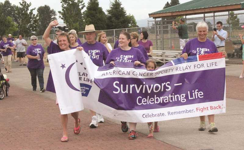 by: TYLER FRANCKE - Cancer survivors, clad in purple shirts, took the first lap around Centennial Park Friday evening to kick off the 13th annual Relay For Life of the Woodburn Area. The event raised more than $66,000 for the American Cancer Society.
