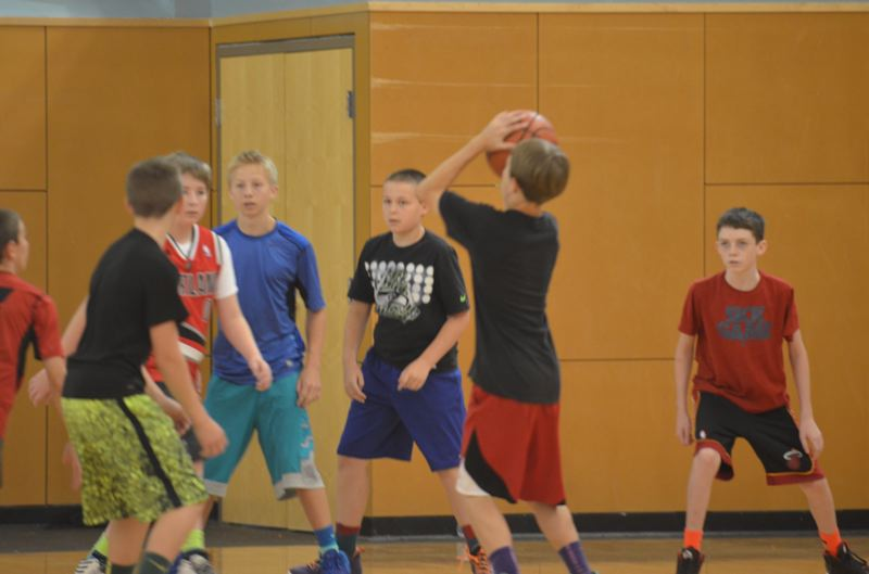 by: COREY BUCHANAN - Joe Nieting pulls up for a jumper during the Wilsonville basketball camp.