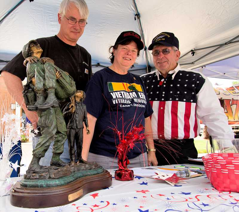 by: RAY HUGHEY - Volunteers staff the memorial booth at General Canby Day.