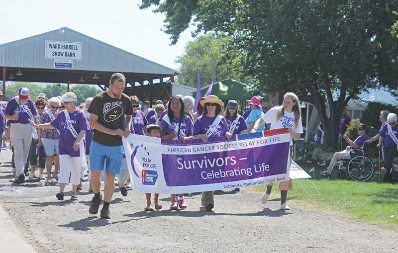 by: JEFF WILSON/MADRAS PIONEER - Cancer survivors take the first lap at Relay For Life, held Friday and Saturday at the Jefferson county Fairgrounds.