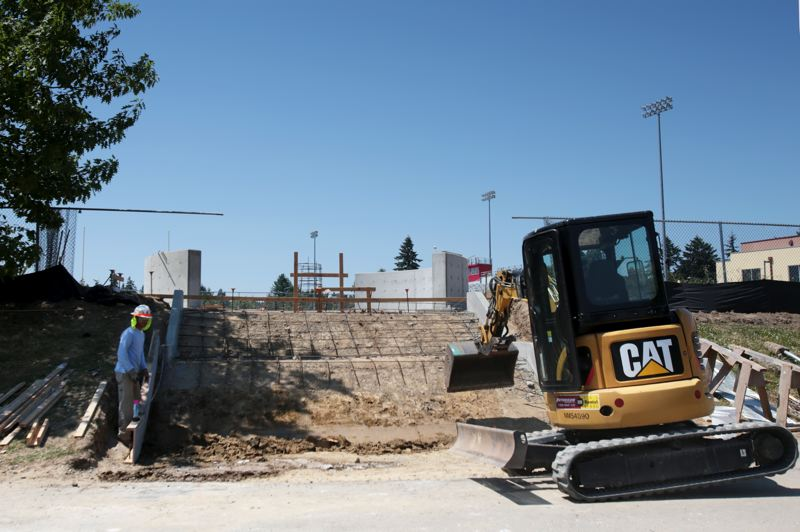 by: TIMES PHOTO: JONATHAN HOUSE - Crews work on the entrance to an inspirational circle leading to the Skyhawk stadium as part of a Southridge Community Plaza Project.