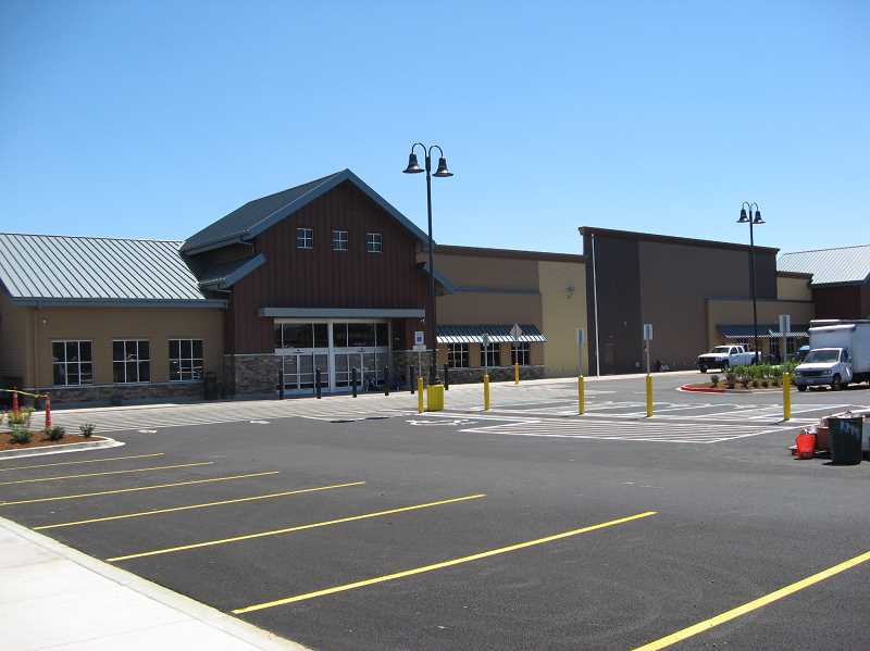 Photo Credit: GAZETTE PHOTO: RAY PITZ - The exterior of the new Sherwood Walmart is different from those of neighboring Walmarts with different colors and architectural elements.