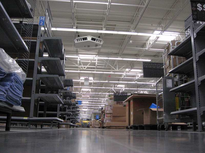 Photo Credit: GAZETTE PHOTO: RAY PITZ - A long empty aisle only for a short time. Up to five semi-trailer truckloads of merchandise are arriving at the Sherwood Walmart Supercenter daily.