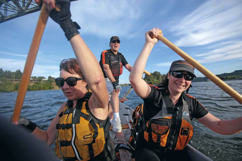 by: TRIBUNE PHOTO: JONATHAN HOUSE - Darrell Hames, middle, is captain and steersperson for the Castaways dragon boat team, one of a growing number that practice year-round.