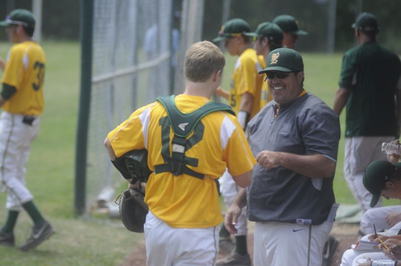 by: MATTHEW SHERMAN - West Linn coach Joe Monahan gives a fist bump to catcher Nicholas Yokubaitis during a recent game at Lakeridge.