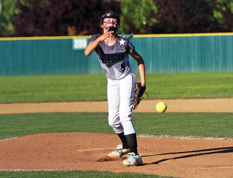 by: DAN BROOD - BRINGING THE HEAT -- Tigard/Tualatin City Little League pitcher Elizabeth Hillier fires a pitch to the plate during the team's 13-1 win over Banks Monday during play at the District 4 tournament.