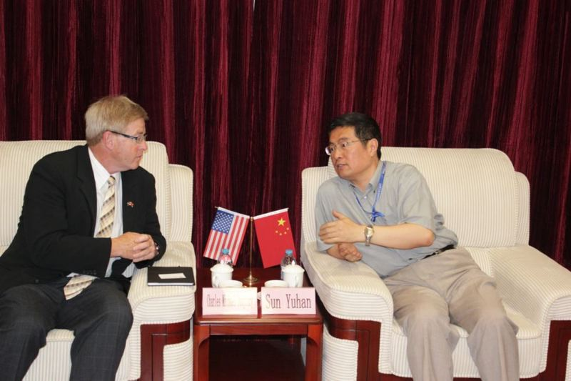by: COURTESY OF COLUMBIA COUNTY ECONOMIC TEAM - Chuck Daughtry (left), executive director of the Columbia County Economic Team, speaks with Sun Yuhan (right), director of the Shanghai Advanced Research Institute. The institute works with the parent company of the developer that has proposed a methanol export facility at Port Westward, the industrial park north of Clatskanie.