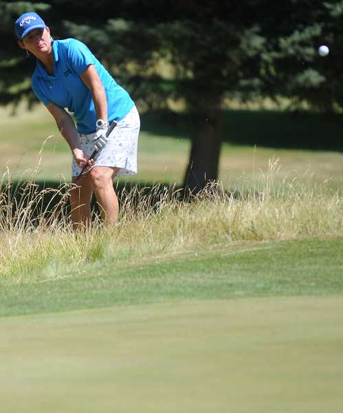 by: LON AUSTIN/CENTRAL OREGONIAN - Marla Pierce chips onto the sixth green during Saturday's first round of the Prineville Invitational Pro-Am. Pierce did not place in the final standings.