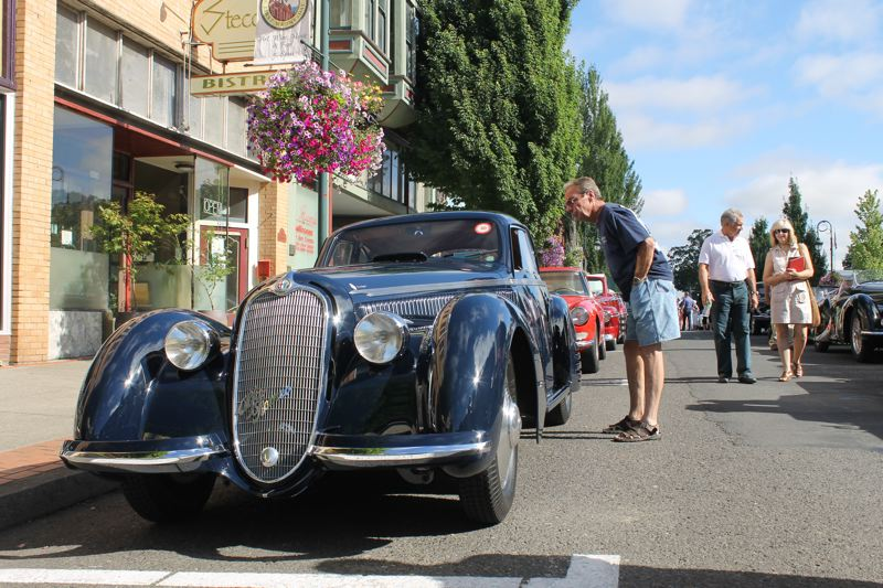 by: CREDIT: PAMPLIN MEDIA GROUP:  JOHN SCHRAG - This 1938 Alfa Romeo got a lot of attention Saturday morning on Main Street Forest Grove, where a parade of classic cars set out for a Vineyard Driving Tour as part of the weekend festivities surrounding the  Forest Grove Concours d'Elegance.