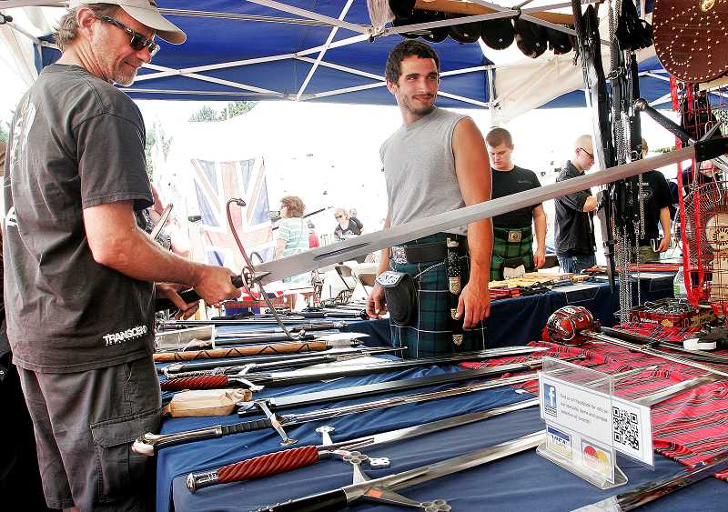 by: OUTLOOK PHOTO: JIM CLARK - Ian Tougher, center, sold swords at the Portland Highland Games at Mt. Hood Community College on Saturday.