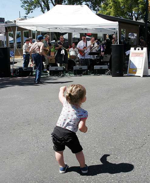 by: OUTLOOK PHOTO: JIM CLARK - Seventeen month-old Maddison Jeppe rocks out to the   performing a the Gresham Arts Festival in downtown Gresham on Saturday