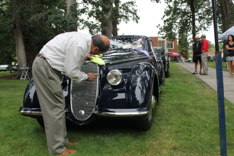 by: PAMPLIN MEDIA GROUP:  JOHN SCHRAG - John Bennett put a final bit of elbow grease into this 1938 Alfa Romeo 8C 2900 Touring Berlinetta  which is on display at today's  Forest Grove Concours d'Elegance.