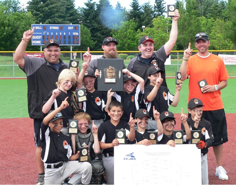 by: SUBMITTED - Gladstone players and coaches proudly display their awards after winning a 15-14 barnburner from Putnam in the final of the 2014 Clackamas County Junior Baseball Midget National Championship Baseball Tournament. Pictured are: (first row, left to right) Amare Mouton, Caleb Conrad, Jacob Marroquin, Joshua Hernandez, Jake Guffee and Asher Gonzolez; (second row) C.J. Peiffer, Cohen Daves, Isiah Conner and Ben Hoffman; and (back) head coach Robert Marroquin, coach Pete Daves, coach Jerry Conner and coach Travis Gonzolez.