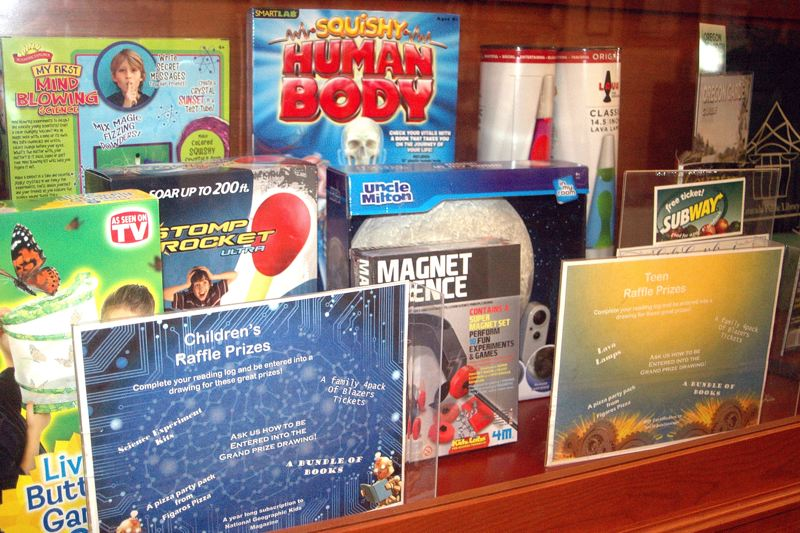 by: OUTLOOK PHOTO: BEVERLY CORBELL - Adults and kids can all win prizes for participating in the Estacada Librarys Summer Reading Program.