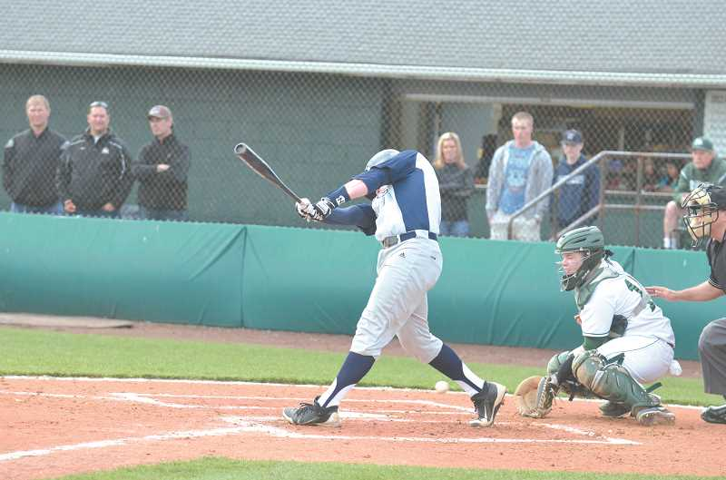 by: JEFF GOODMAN - A Wilsonville player swings at a low pitch during a game between Wilsonville and North Marion last season.