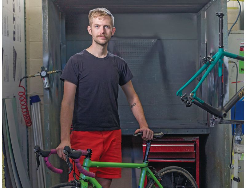 by: JOSEPH GALLIVAN - If it aint broke: bike frame repair shop Ruckus Composites was lucky to expand into this standalone space on SE Stark by the train tracks as the central east side becomes too crowded and unaffordable for three man businesses.