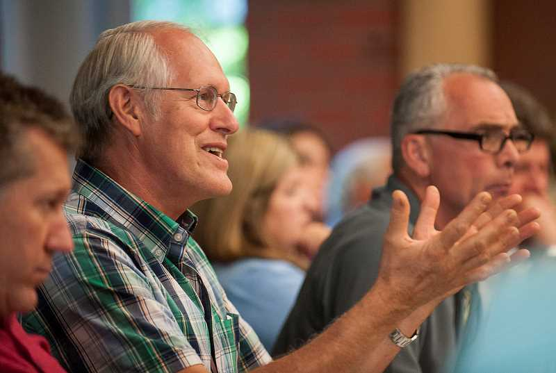 by: SPOKESMAN PHOTO: JOSH KULLA - Wilsonville Mayor Tim Knapp raises a point July 16 at a joint Tualatin-Wilsonville city council meeting on the future of Basalt Creek.