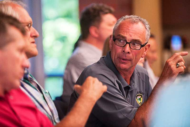 by: SPOKESMAN PHOTO: JOSH KULLA - Tualatin Mayor Lou Ogden is shown here at a July 16 joint Wilsonville-Tualatin city council meeting to discuss the future of Basalt Creek.