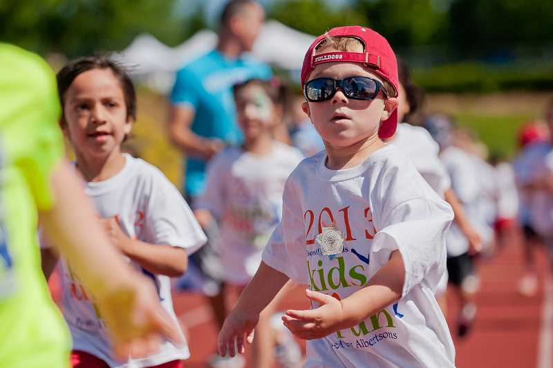 by: SPOKESMAN FILE PHOTO: JOSH KULLA - Children from 3-14 are invited to the annual Wilsonville Kids Fun Run, set this year for July 26 at Wood Middle School.