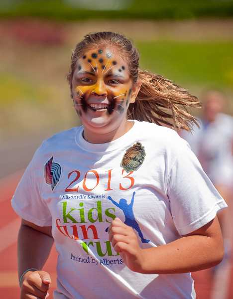 by: SPOKESMAN FILE PHOTO: JOSH KULLA - Facepainting and other fun activities are part of the package each year at the Wilsonville Kiwanis Kids Fun Run.