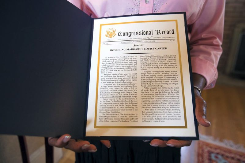 by: TRIBUNE PHOTO: JONATHAN HOUSE - Carter holds a copy of the U.S. Congressional Record with a floor speech praising her decades of service in Oregon.