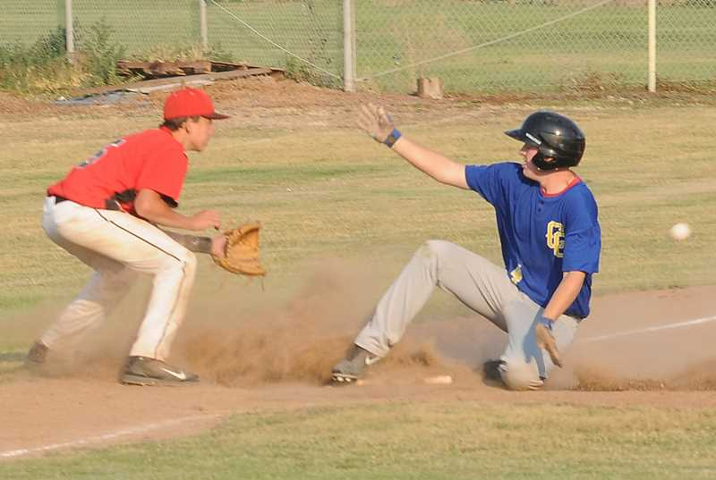 by: LON AUSTIN/CENTRAL OREGONIAN - Trevor Slawter slides safely into third with a triple during the Cowboys' doubleheader against the Sisters Outlaws. Sisters won the first game 5-4, but the Cowboys came back to win game two 17-7 in six innings.