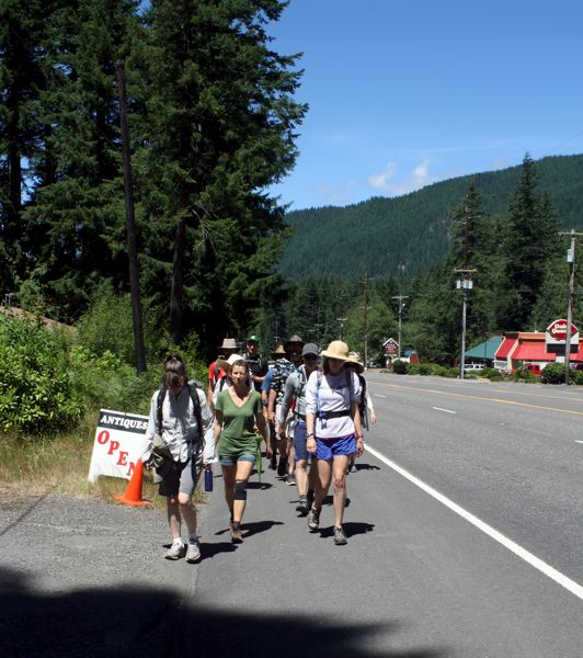 by: POST PHOTO: KYLIE WRAY - Despite trying to stick to trails as they got closer to Mount Hood, the group did cross Highway 26 in Rhododendron after stopping at Dairy Queen on a hot afternoon.