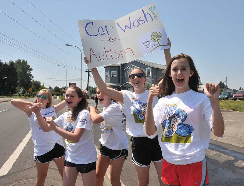 by: PAMPLIN MEDIA GROUP: VERN UYETAKE - From left, Emma Wells, Maddie Wick, Haley Thayer, Lauren Griffith adn Katy Miller work near Wanker's Corner, waving in customers for the Tiffany Autism Foundations Friends of Connor carwash.