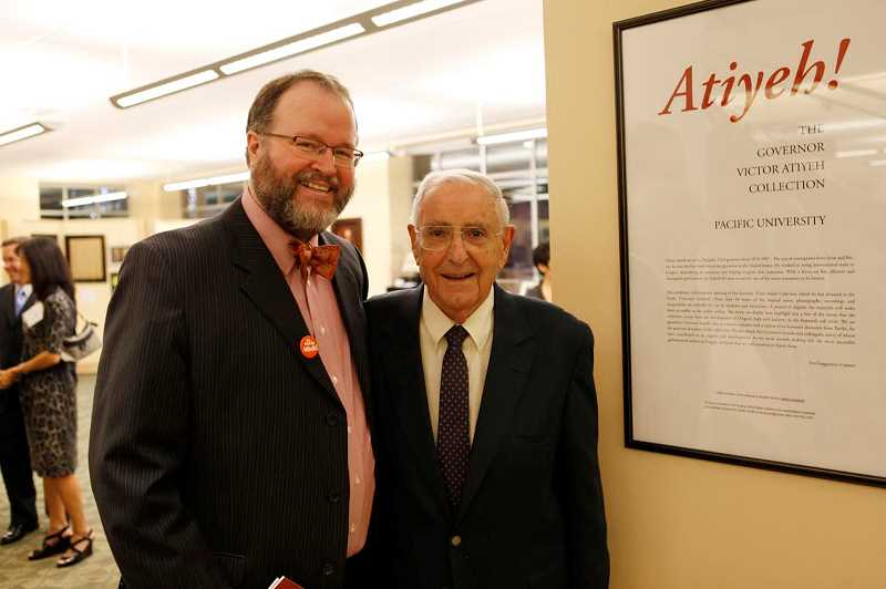 Pacific professor Jim Moore stood with Atiyeh last fall.
