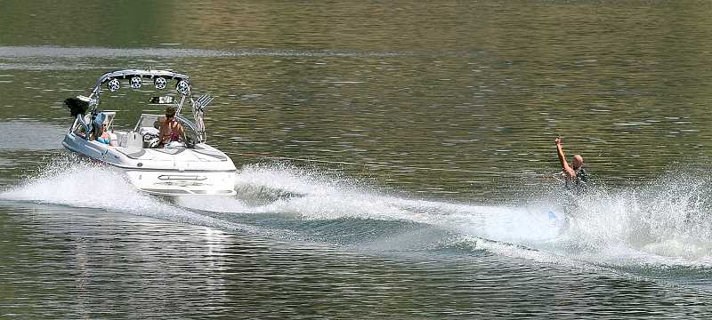 by: GARY ALLEN - Beat the heat - Staying cool is vital to staying healthy during warm summer days. Many in the area find boating and wakeboarding on the Willamette River a fun solution.