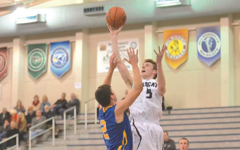 by: JEFF GOODMAN - Tyler Hieb releases a floater while elevating over a defender last season.