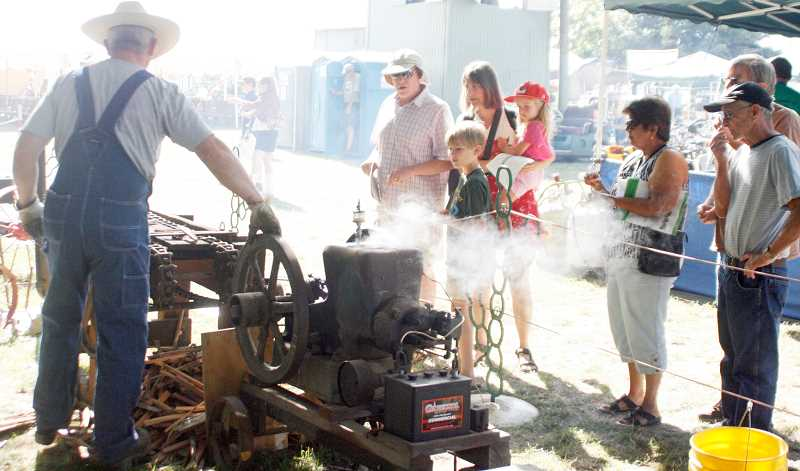by: PHIL HAWKINS - Volunteer demonstrators travel from throughout the Northwest to show up their fully functional steam-powered machinery to the public.