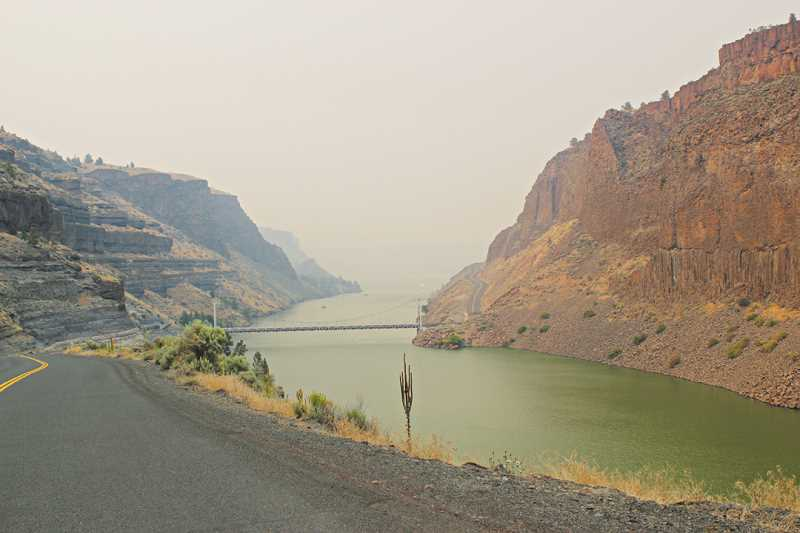by: HOLLY M. GILL - Looking south toward the Cove from Jordan Road, smoke blocked the view of the water on Friday.