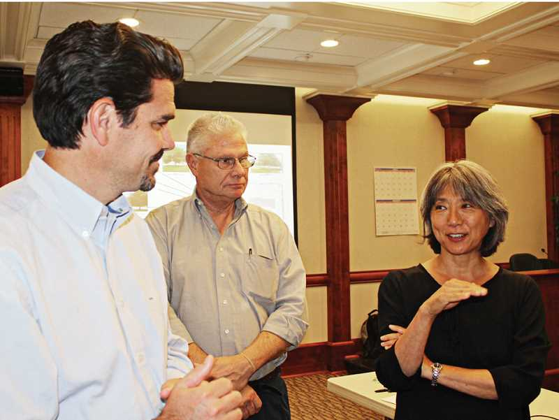 by: HOLLY M. GILL - Bill Valdez, left, principal with DLR Group, which is designing the courthouse, along with Larry Smith, also of DLR, and Leslie Hara Shick, principal with HSR Architecture, right, discuss the plans following the public meeting.