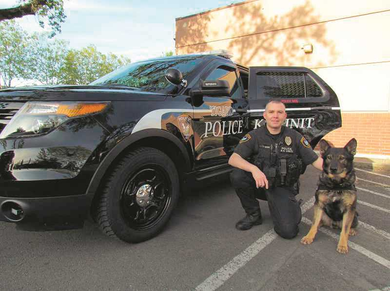 by: FILE PHOTO - Tigard Police and the Tigard Breakfast Rotary will be hosting a bicycle safety fair at Tigard Burgerville on Saturday as a fundraiser for a new K-9 unit. Bring your bike and helmet to Burgerville from 11 a.m. to 1 p.m.