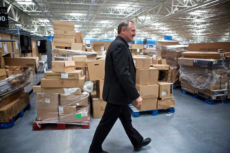 by: TIMES PHOTO: JAIME VALDEZ - Boxes of products are delivered to the new Sherwood and Tigard Walmarts every day, said Dion Hess, general manager of the Tigard store.