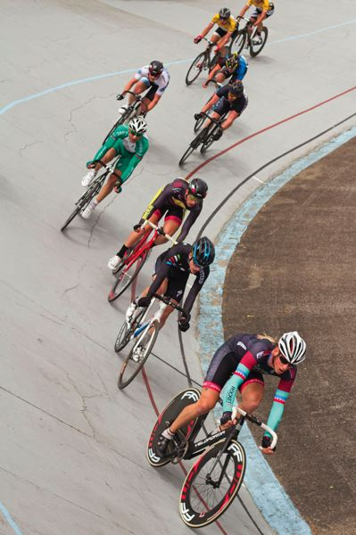 by: TIMES PHOTO: LACEY JACOBY - Racers maintain speeds of 12.5 mph or faster to stay upright at Alpenrose Dairy Velodrome.