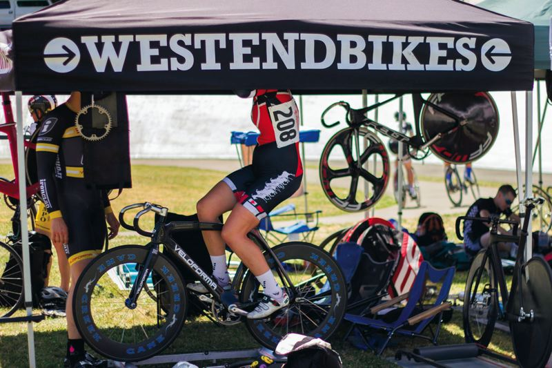 by: TIMES PHOTO: LACEY JACOBY - A disguised Erin Goodall warms up before her Alpenrose Velodrome Challenge race last weekend.