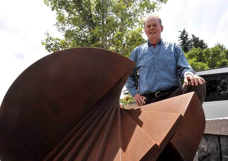 by: REVIEW PHOTO: VERN UYETAKE - Sculptor James Ellingboes Twist will sit on First Street, across from St. Honoré Bakery.