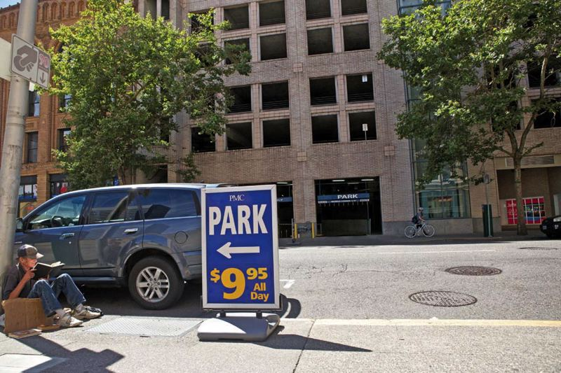 by: TRIBUNE PHOTO: JAIME VALDEZ - It can be hard to figure out exactly what the price would be for parking in this PMC garage on Southwest Third Avenue. especially since the same buildings entrance on Fourth Avenue features Smart Park $1.60 an hour parking. This entrance? $5 an hour.