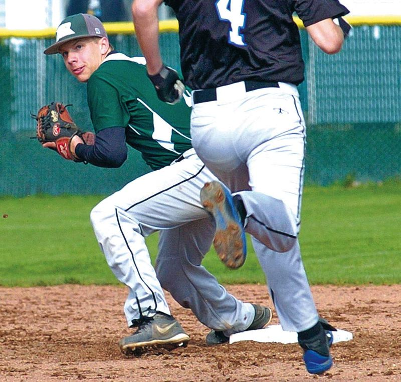 by: PAMPLIN MEDIA GROUP: DAN BROOD - Jay Rogers (left), making a play on defense this spring for Reynolds High, has been the leading hitter for the American Legion Zone 2 champion Portland Barbers.